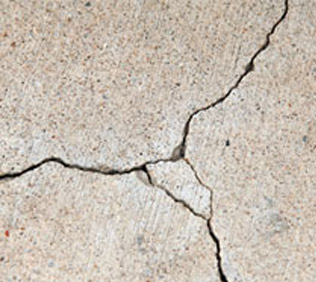 Exterior wall rendering cracks showing in property in Surrey